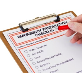 Hand completing Emergency Preparation List