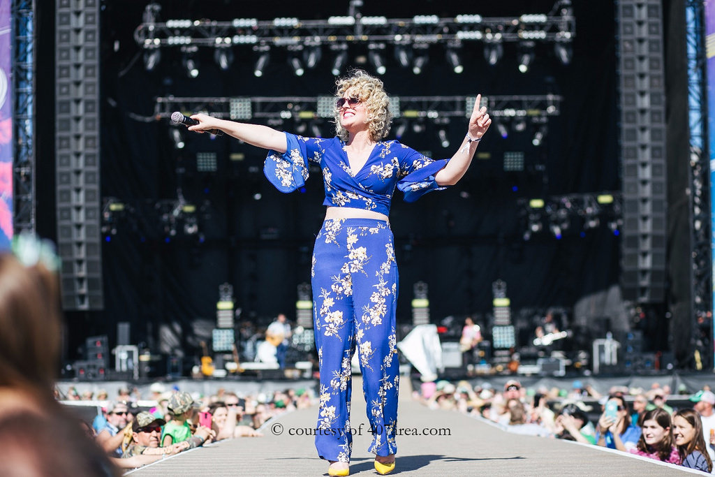 Runaway Country Music Fest, female singer holds microphone out to audience on stage runway